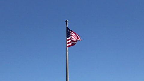 American flag blows gently in the wind from ocean breezes