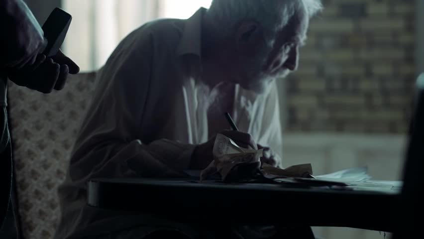 Soldier of the Russian army interrogates a suspect, an elderly man with a beard, under pain of execution, signs papers, the injustice of the NKVD, cynicism of the soldiers, the cruelty of the USSR | Shutterstock HD Video #1021575211