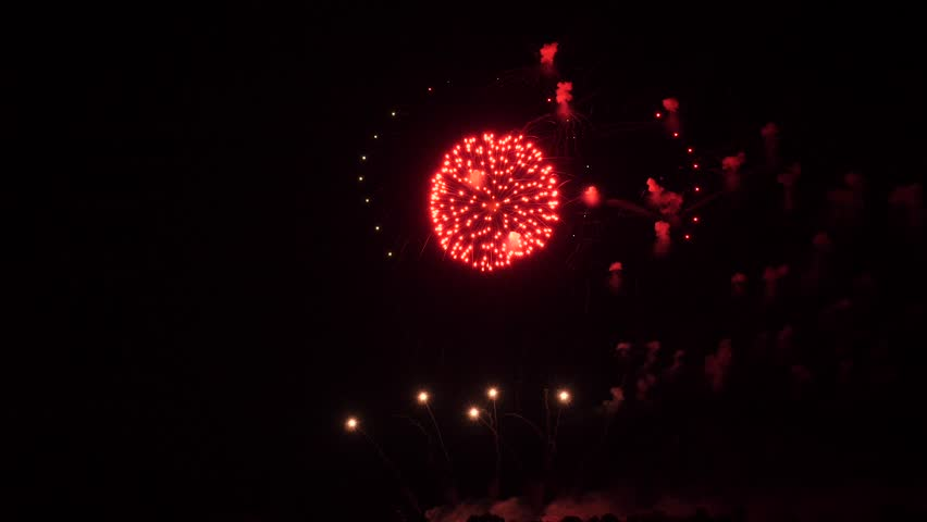Slow motion fireworks show, half rings and red balls with glitter | Shutterstock HD Video #1021581748