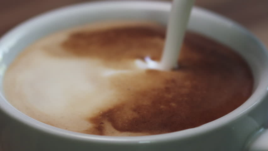 Slow motion closeup steamed milk pour into cappuccino | Shutterstock HD Video #1021586398