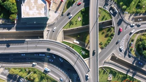 Aerial video shooting. Transport. Cars are driving on the road. The view from the top. Transport ring. Interchange. Way. The car.