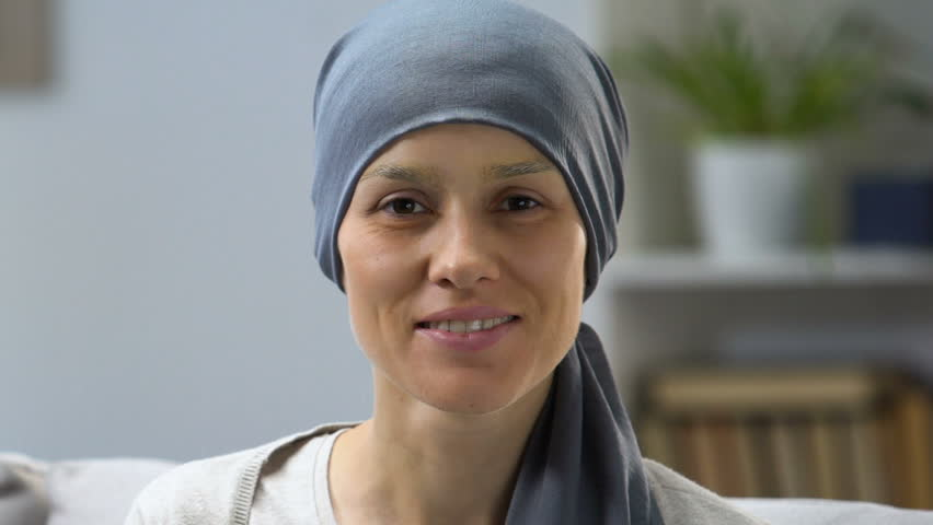 Happy cancer survivor woman smiling at camera, remission and hope for recovery