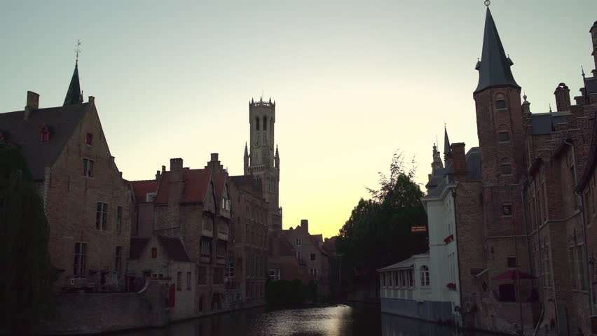 Bruges cityscape with the famous landmark Rozenhoedkaai canal and Brugge Belfry bell tower after sunset   Shutterstock HD Video #1021636615