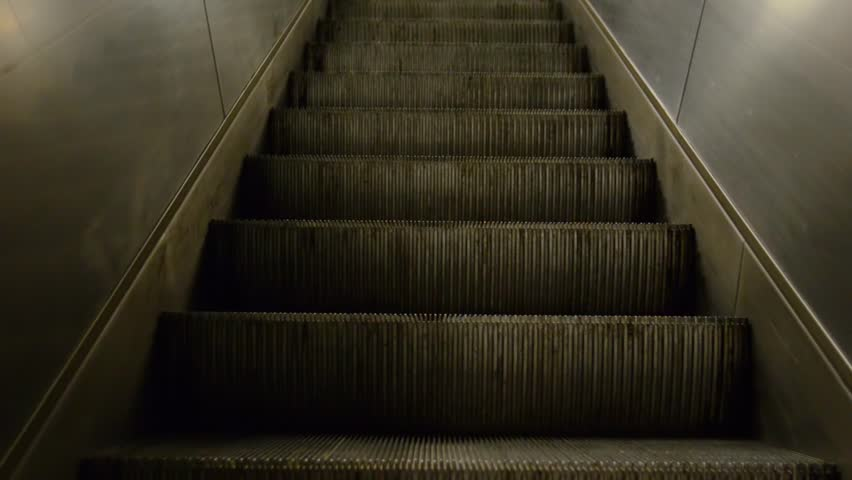 Close-up. The ladder goes up. escalator. Mesto  | Shutterstock HD Video #1021639681