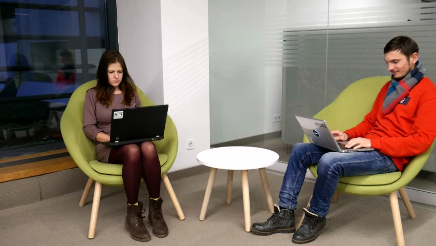 Two freelancers work remotely using gadgets. Bloggers are working on a new post. Young Owner People Start up for Business Online, SME.  Royalty-Free Stock Footage #1021644799