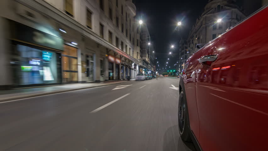 ar moves at fast speed at the night avenue timelapse hyperlapse drivelapse. Blured road with lights reflected from car on high speed. Milan, Italy | Shutterstock HD Video #1021650973