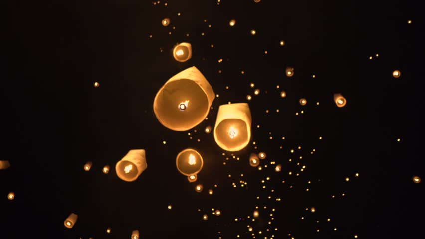 Floating lanterns in the night sky. Launching Sky Lantern. Yee Peng Festival, Loy Krathong celebration.