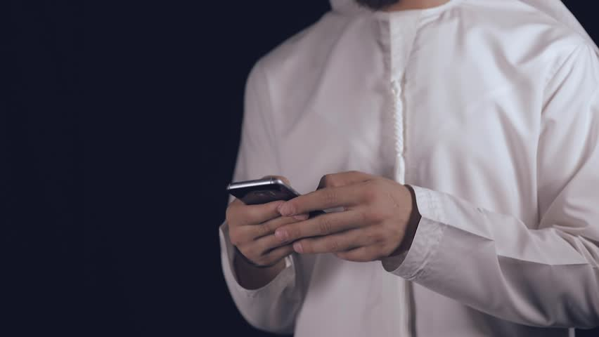 Arab man using his smartphone | Shutterstock HD Video #1021687666