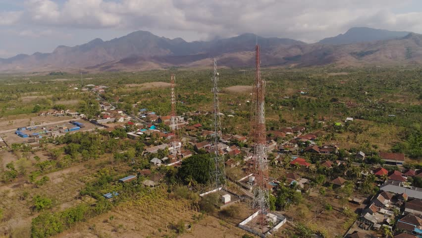 Aerial view cell phone towers line in bali, indonesia. Telecommunication tower, communication antenna on coast sea | Shutterstock HD Video #1021800721