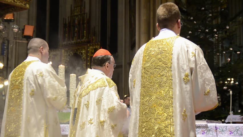 Catholic priests perform the Midnight Mass at Cathedral. Liturgy in church. Religion. People are praying.  Roman Catholic service