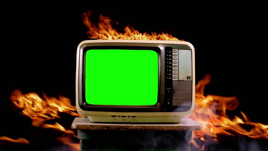 """An Old Retro TV Green Screen Burning. Zoom In. You can Replace Green Screen with the Footage or Picture you Want with """"Keying"""" effect in After Effects (check out tutorials on YouTube)."""