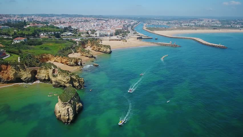 Aerial. Beautiful Portuguese beaches and shores of the city of Lagos. View from the sky, Algarve. Royalty-Free Stock Footage #1021807885