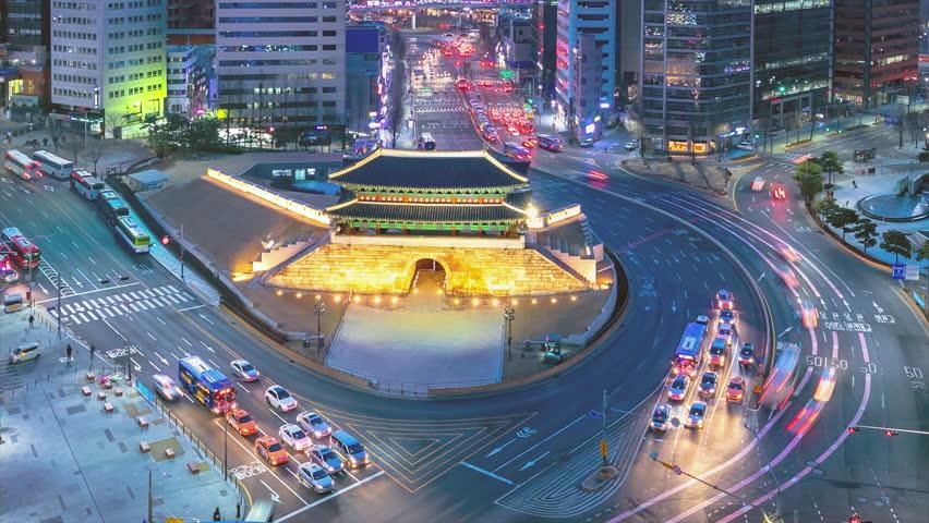 Traffic at old fortress Namdaemun gate in Seoul South Korea.