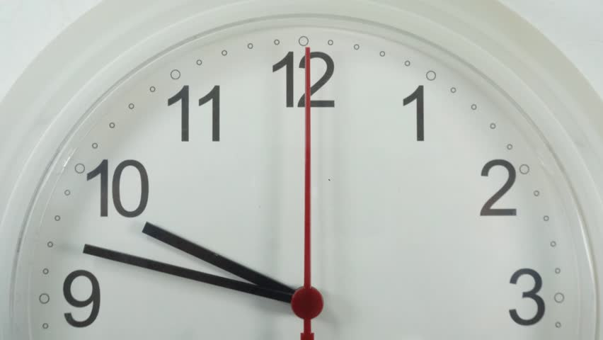 Time lapse Close-up White clock hanging on the wall Start time 09.48 Clock walking 20 minutes.