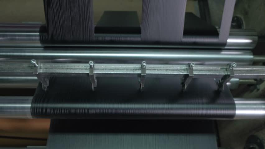Lamination of doors, drawing veneer, the production of interior doors 4k   Shutterstock HD Video #1021914334