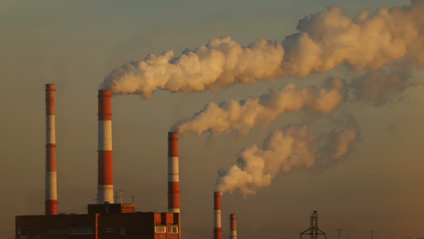 Industrial zone with a large red and white pipe thick white smoke is poured from the factory pipe in contrast to the sun. Pollution of the environment: a pipe with smoke. Seamless cinemagraph video. | Shutterstock HD Video #1021932388
