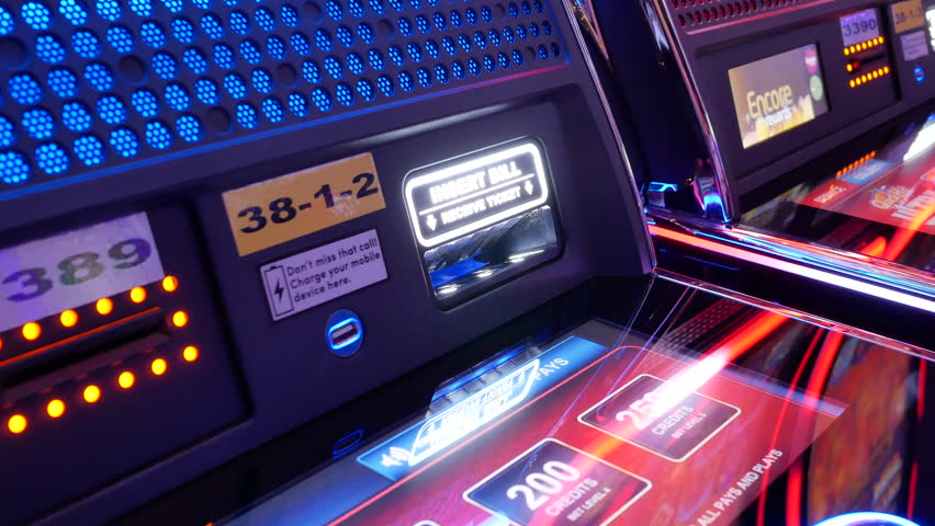 Coquitlam, BC, Canada - June 12, 2018 : Motion of woman inserts ticket on slot machine inside Casino with 4k resolution | Shutterstock HD Video #1021949386