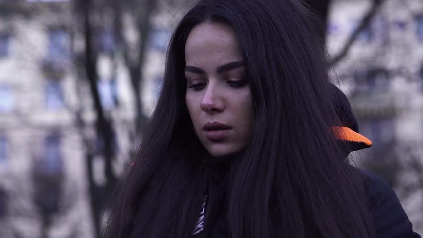 Portrait of a beautiful, sad woman   Shutterstock HD Video #1021969804