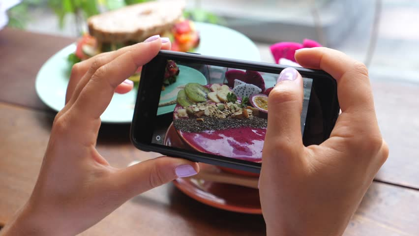 Woman Hands Taking Photo Of Smoothie Bowl Using Smartphone. Food Photography, Social Media, Blogging Concept. #1021986037