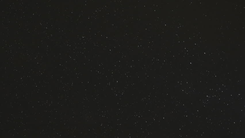 White snow against the black night sky, slow motion   Shutterstock HD Video #1021997077