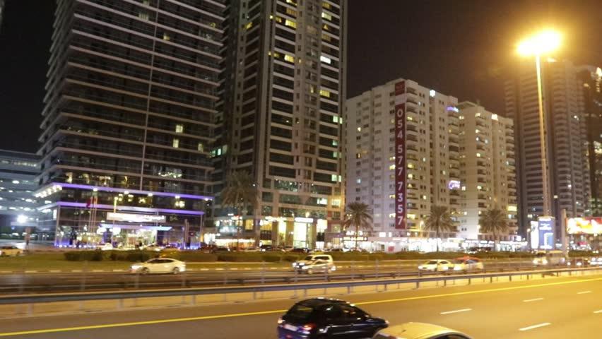 Dubai, United Arab Emirates - January 8, 2019 : Commercial Business Building at Night in Dubai, UAE. | Shutterstock HD Video #1022013424