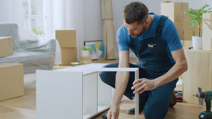 Successful Furniture Assembly Worker Uses Stock Footage Video 100 Royalty Free 1022013502 Shutterstock