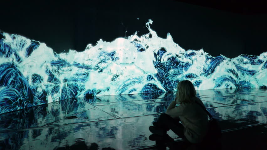 """HELSINKI, FINLAND - JAN 06, 2019: """"Massless"""" Exhibition - immersive interactive graphic digital installations by a group of Japanese artists TeamLab at the Amos Rex Museum. Visitors at museum enjoy"""