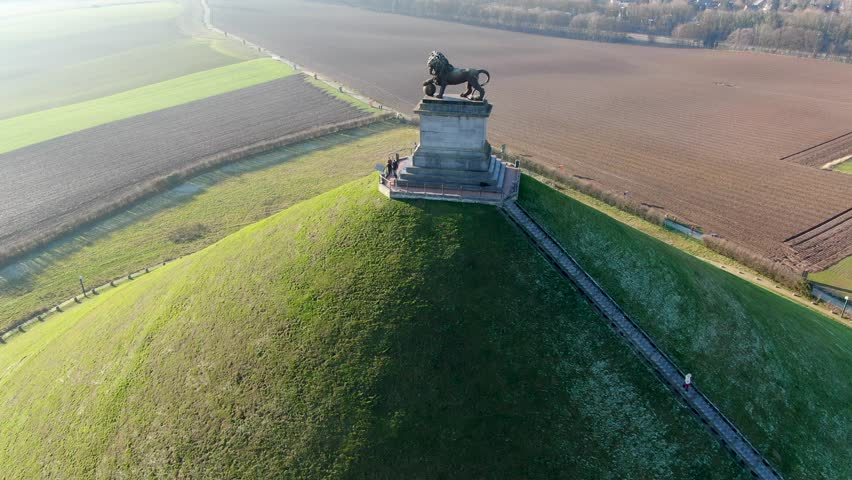 Aerial view of The Lion's Mound with farm land around.  The immense Butte Du Lion on the battlefield of Waterloo where Napoleon died. Belgium.  Royalty-Free Stock Footage #1022042455