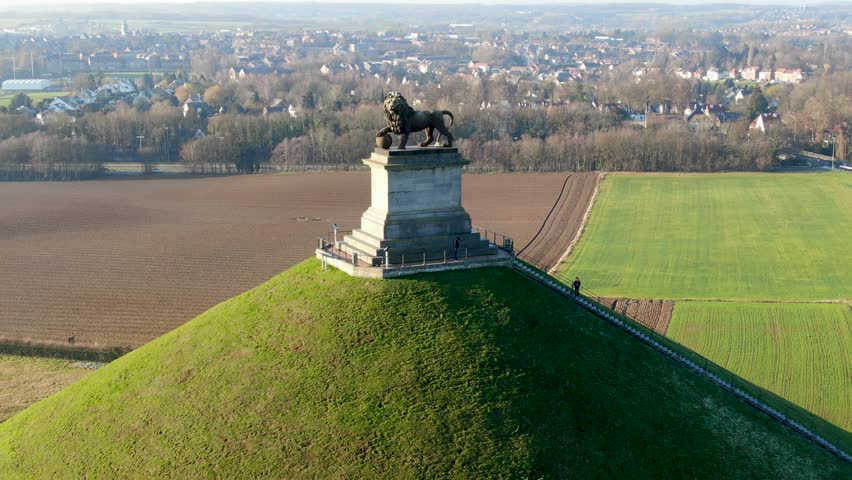 Aerial view of The Lion's Mound with farm land around.  The immense Butte Du Lion on the battlefield of Waterloo where Napoleon died. Belgium.  Royalty-Free Stock Footage #1022042458