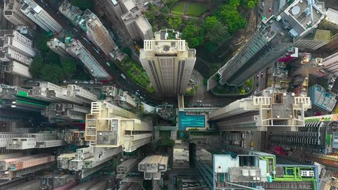 HONG KONG - MAY 2018: Aerial look-down view of Causeway Bay district, city downtown with residential and office buildings and skyscrapers, hight-density development, drone shot in 4K