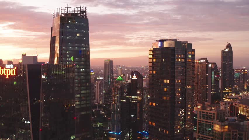 JAKARTA, Indonesia - January 02, 2019: Aerial panorama of silhouette of skyscrapers at dusk time in business district. Shot in 4k resolution | Shutterstock HD Video #1022067043