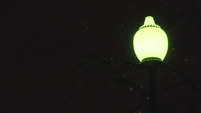 Street lamp during snowfall in the dark | Shutterstock HD Video #1022070247