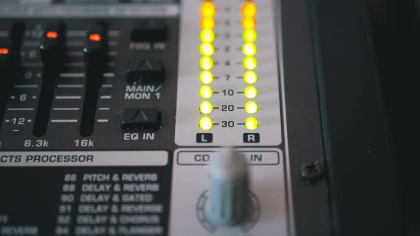 LED Indicator Level Signal on the Sound Mixing Console. Led light output level indicator. The volume level changes with green, yellow and red indicator lights. Peak level, volume meters of an analog | Shutterstock HD Video #1022083639