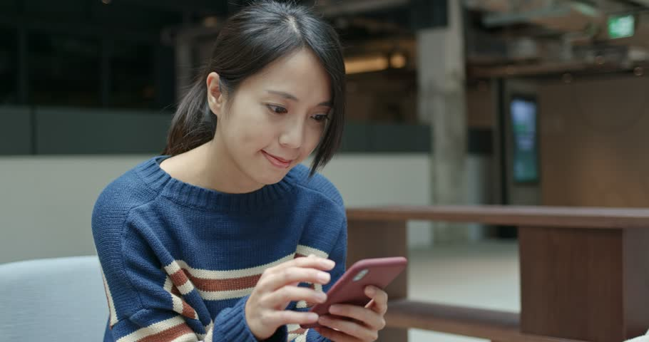 Woman use of mobile phone at outdoor   Shutterstock HD Video #1022093815