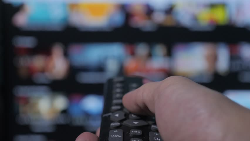 Smart tv. online video streaming service. with apps and hand. Male lifestyle hand holding remote the control turn off smart tv. man hand controls holding remote. concept internet online cinema   Shutterstock HD Video #1022107279