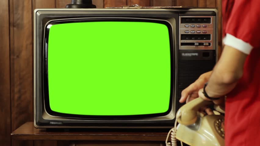 """Teenage Boy Talking On Phone, and Turns On Old Tv Green Screen. You can replace green screen with the footage or picture you want. You can do it with """"Keying"""" effect (check out tutorials on YouTube).  