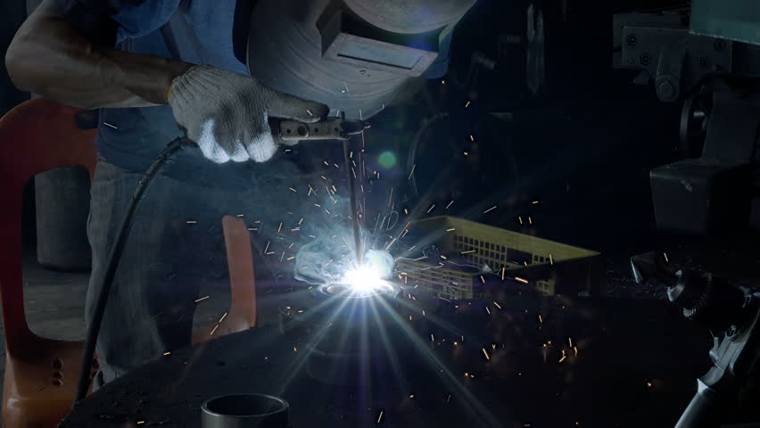 Men's hands motion with welding machine part in industrial construction factory. 4k Video Slow motion   Shutterstock HD Video #1022137519