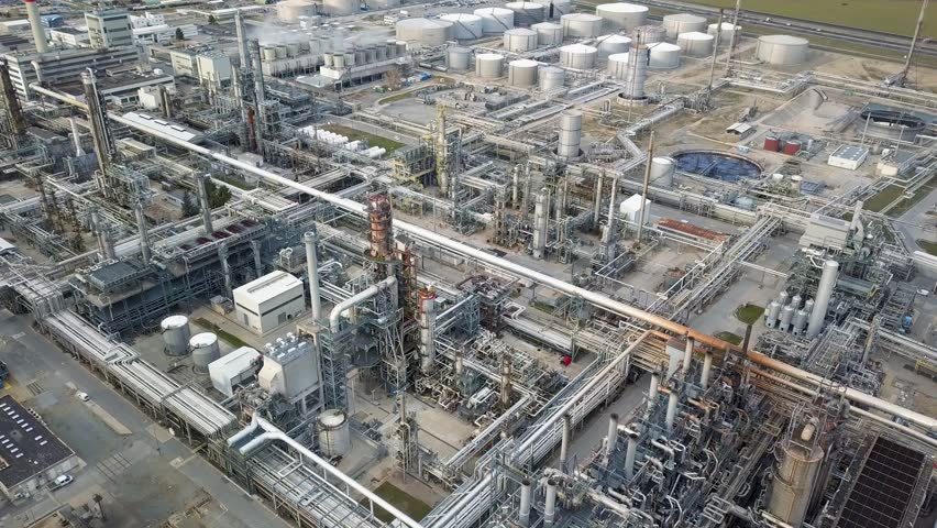 Aerial drone view of huge oil refinery | Shutterstock HD Video #1022156599
