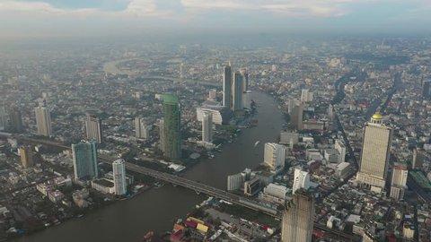 Fly over Chaophraya river bangkok in sunset scene, 4k video