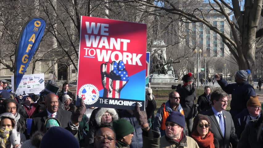 WASHINGTON, DC - JAN. 10, 2018: Protesting the partial government shutdown, hundreds of furloughed as well as unpaid federal workers, march to the White House after rally at AFL-CIO headquarters.