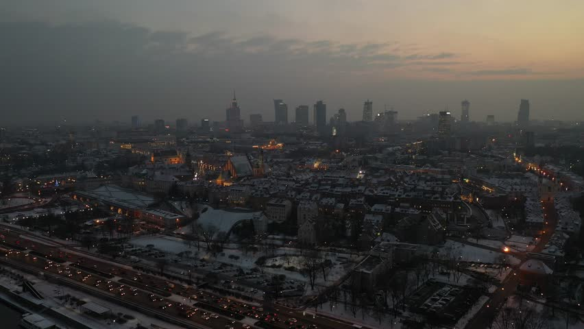 Aerial warsaw city panorama at sunset from river side view at castle and city skyliners with first snow   Shutterstock HD Video #1022191831