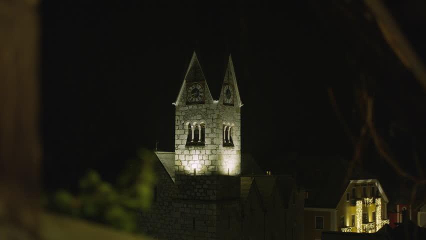 Hallstatt - March, 2018: Clock tower and buildings at night.   Shutterstock HD Video #1022201038