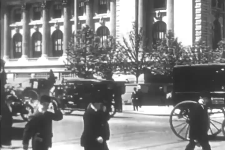 CIRCA 1890s - Silent footage of a paper boy and women going to work in the sewing factories of New York in the 1890s