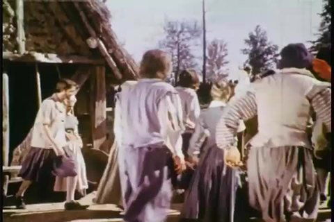 CIRCA 1958 - Re-energized English settlers work zealously in 1610 Jamestown.