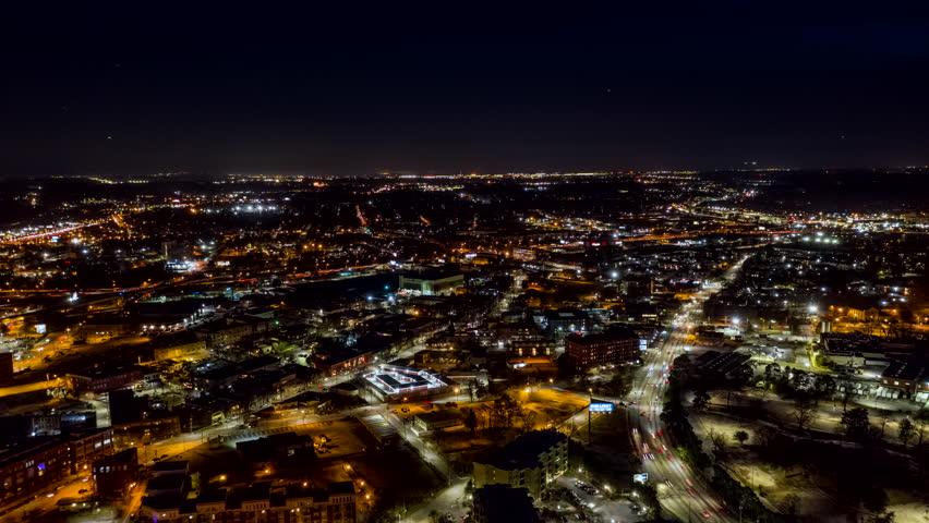 Atlanta Aerial v488 Hyperlapse in reverse over city center with stadium view at night 12/18