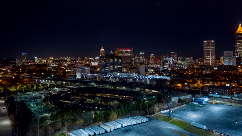 Atlanta Aerial v490 Hyperlapse flying toward downtown cityscape with dense freeway traffic at night 12/18