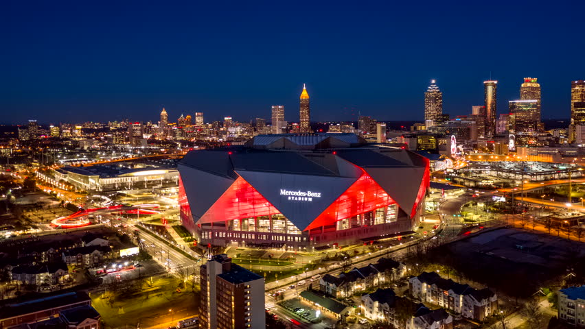 Atlanta Aerial v484 Dusk to night hyperlapse rotating around Mercedes-Benz Stadium with bright red lights 12/18