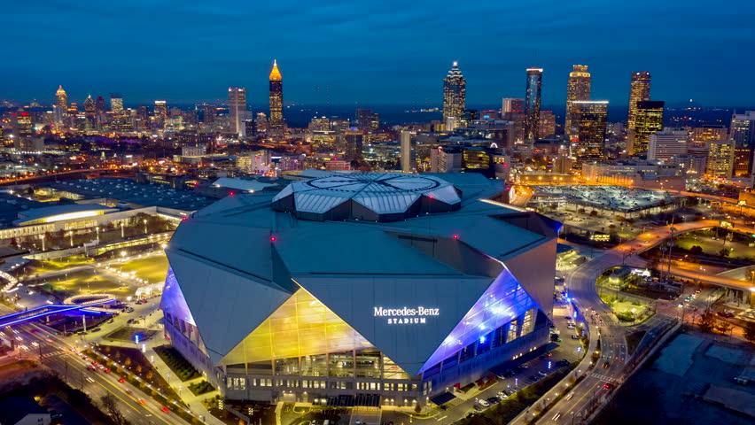 Atlanta Aerial v485 Dusk to night hyperlapse rotating around Mercedes-Benz Stadium and back at dusk with blue lights 12/18
