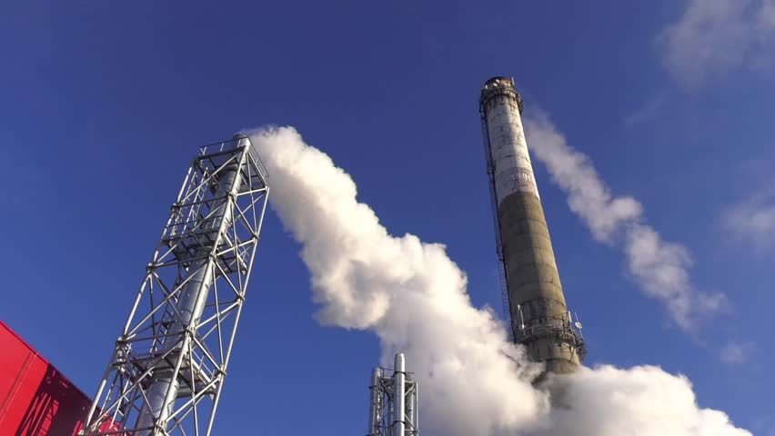 The energy industry. industrial chimney exhausting steam in blue sky. industrial site with smoking pipes, global warming concept. Smoke from the stalk ecology problems. Reset steam into the atmosphere | Shutterstock HD Video #1022243530