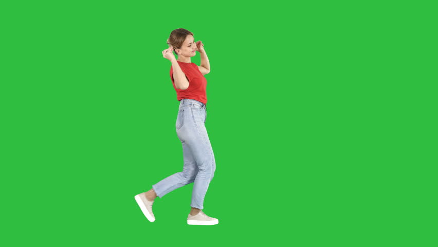 Happy smiling woman dancing and having fun on a Green Screen, Chroma Key.